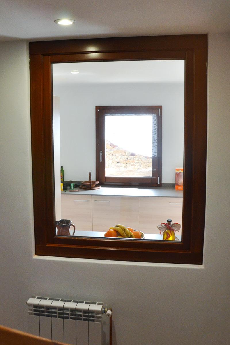 ventanas mixtas de madera y aluminio aislamiento térmico fabricadas por Carrteté Finestres en Queralbs Cataluña- Ripollès ventanas de seguridad