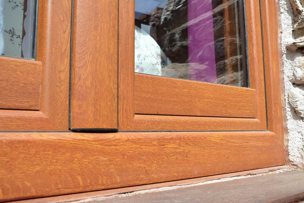 ventanas mixtas de madera y aluminio aislamiento térmico fabricadas por Carreté Finestres en Queralbs Cataluña- Ripollès ventanas de seguridad