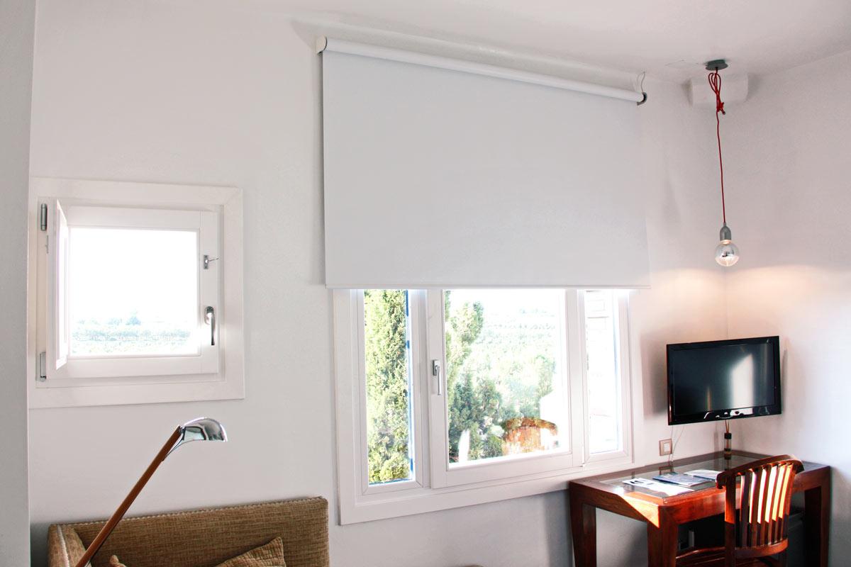 rehabilitación Hotel Mas Passamaner ventanas de madera fabricadas por Carreté Finestres fabrica de ventanas en La Selva del Camp-arquitectura original