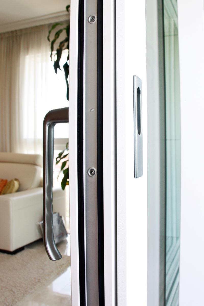 ventanas de madera y aluminio exterior correderas y elevables, acabados de gran calidad con manija Hoppe fabricadas por Carreté Ventanas