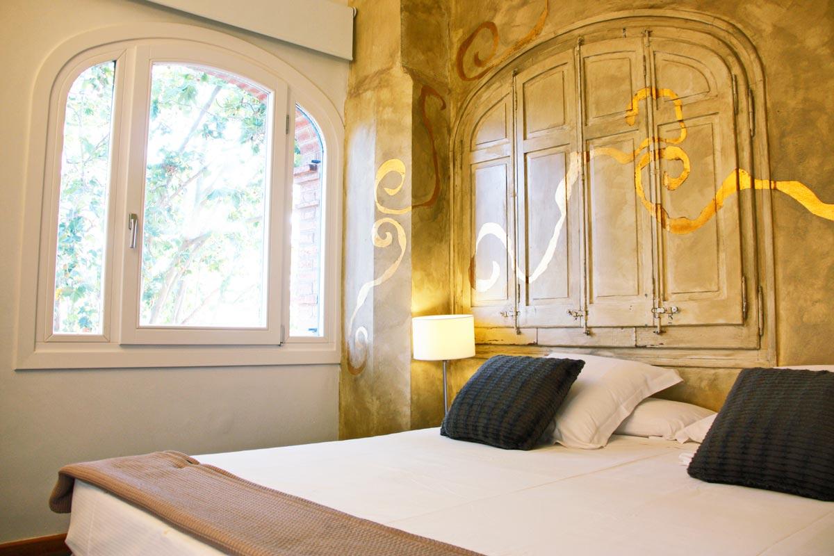 rehabilitación Hotel Mas Passamaner ventanas de madera fabricadas por Carreté Finestres fabrica de ventanas en La Selva del Camp-habitación de 5 estrellas