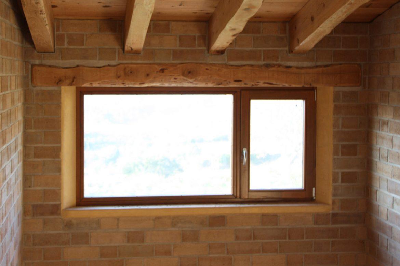 casa ecologica cerramientos de madera fabricadas por casa sostenible y ecológica en Montmell por Carreté Finestres fabrica de ventanas-casa pasiva y construcción ecológica