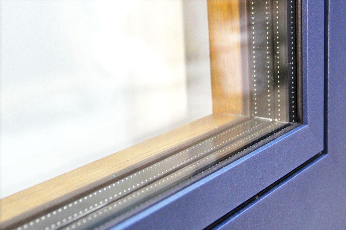 Carreté Finestres - ventana mixta de madera y aluminio Flat con triple junta de goma