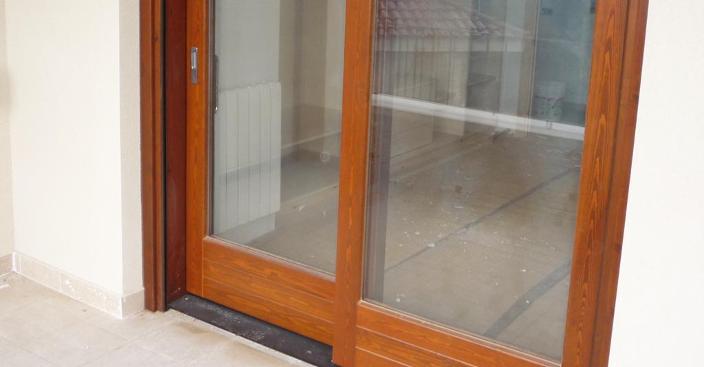 Carreté Finestres - tancament porta corredissa elevadora
