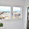 finestra de fusta i alumini de la sèrie fènix de pi amb lacat blanc a Reus al Baix camp - Carreté Finestres