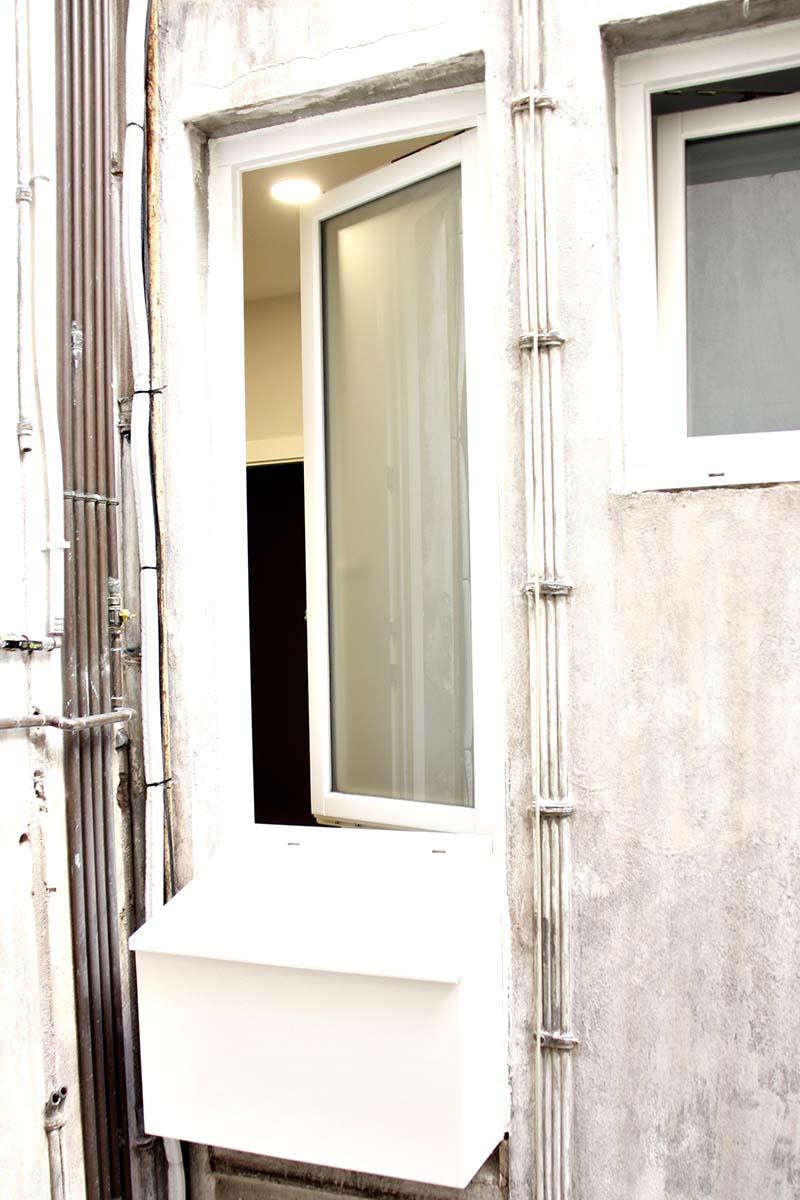 finestra de fusta amb fresquera en pis de Sant Gervasi a Barcelona - Carreté Finestres