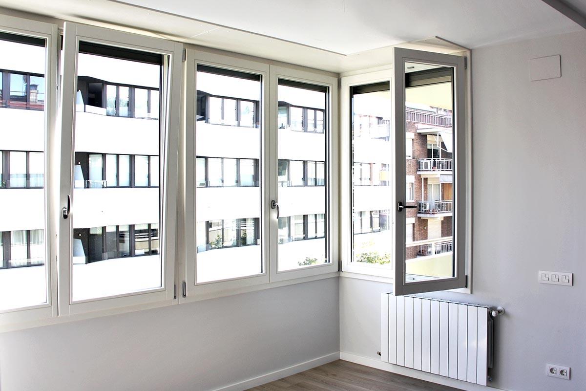 ventanas de madera de calidad con aislamiento térmico y acústico en piso en Sant Gervasi en Barcelona - Carreté Finestres