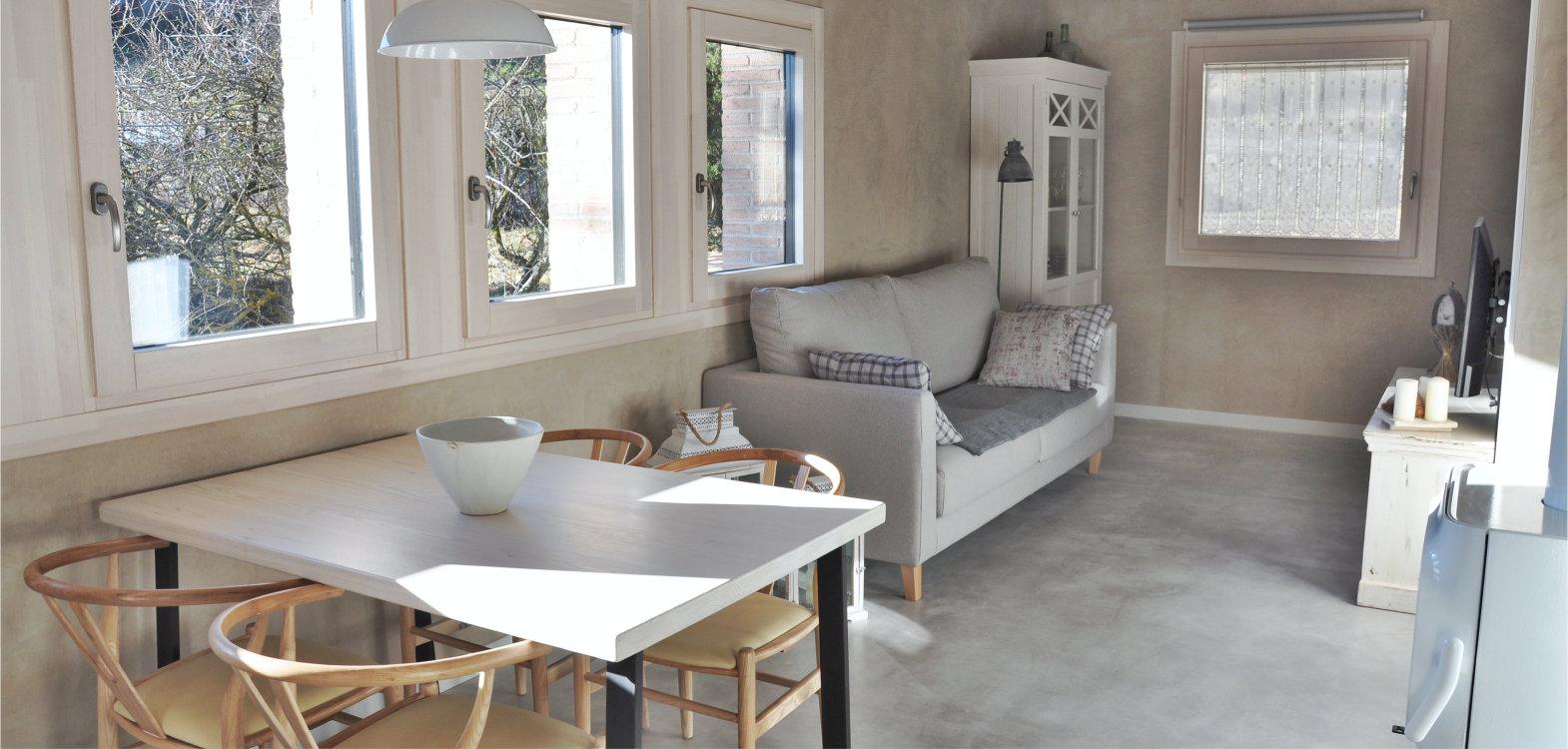 ventanas de madera aluminio con triple acristalamiento aislamiento termico seguridad carrete finestres l'era den bella solsones