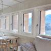 ventanas de madera y aluminio con triple acristalamiento en casa de montaña carrete finestres era den bella solsones