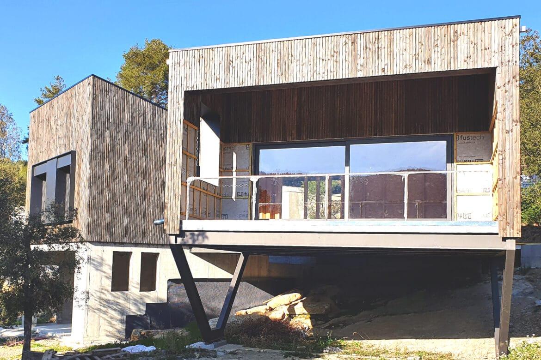 Casa pasiva con ventanas de madera y aluminio en Girona - Carreté Finestres